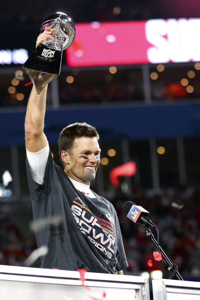 Tampa Bay Buccaneers quarterback Tom Brady (12) holds the Vince Lombardi trophy following the NFL Super Bowl 55 football game against the Kansas City Chiefs, Sunday, Feb. 7, 2021 in Tampa, Fla. Tampa Bay won 31-9. (Ben Liebenberg via AP)