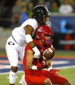 Arizona wide receiver Shawn Poindexter, right, makes the catch as he shields Oregon cornerback Thomas Graham Jr. from the ball in the first half during an NCAA college football game, Saturday, Oct. 27, 2018, in Tucson, Ariz. (AP Photo/Rick Scuteri)