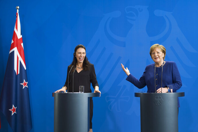 German Chancellor Angela Merkel, right, and the Prime Minister of New Zealand Jacinda Ardern, left, brief the media after a meeting at the chancellery in Berlin, Germany, Tuesday, April 17, 2018. (AP Photo/Markus Schreiber)