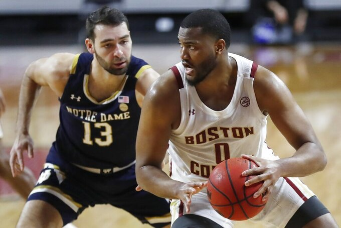 Boston College's Frederick Scott (0) drives past Notre Dame's Nikola Djogo (13) during the second half of an NCAA college basketball game, Saturday, Feb. 27, 2021, in Boston. (AP Photo/Michael Dwyer)