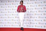 Actress Priyanka Chopra Jonas poses for photographers upon arrival at the Bafta Film Awards, in central London, Sunday, April 11 2021. (AP Photo/Alberto Pezzali)