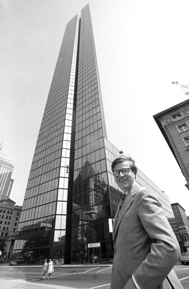 File-This Sept. 13, 1977, file photo shows architect Henry N. Cobb, across from the John Hancock Tower in Boston. Cobb, an architect who designed the tallest building in New England, has died at the age of 93. Cobb worked on numerous buildings throughout his 70 year career. His most celebrated being the 800-foot-tall glass skyscraper 200 Clarendon, the former John Hancock Tower in Boston. Cobb died Monday, March 2, 2020, at his Manhattan home, according to his firm, Pei Cobb Freed & Partners. (AP Photo/Chet Magnuson, File)