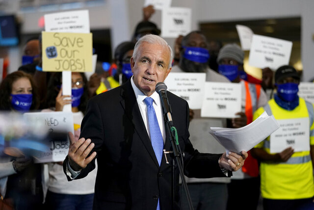 Miami-Dade County Mayor Carlos Gimenez speaks during a protest at PortMiami by workers in the cruise ship industry wanting to return to work, Wednesday, Oct. 21, 2020, in Miami. The Centers for Disease Control and Prevention (CDC) issued a No Sail Order for cruise ships through Oct. 31 during the coronavirus pandemic. (AP Photo/Lynne Sladky)