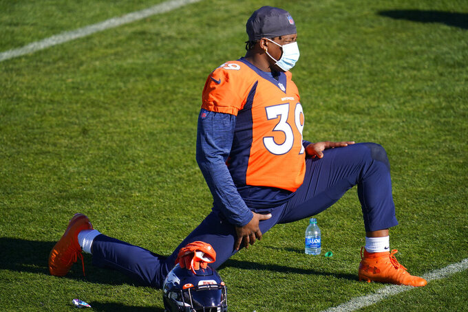 Denver Broncos safety Kahani Smith takes part in drills during an NFL football practice at the team's heasdquarters Wednesday, Nov. 25, 2020, in Englewood, Colo. (AP Photo/David Zalubowski)