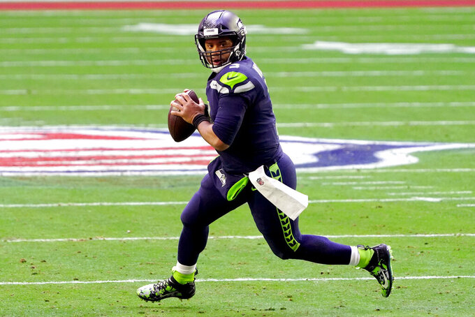 Seattle Seahawks quarterback Russell Wilson (3) looks to pass against the San Francisco 49ers during the first half of an NFL football game, Sunday, Jan. 3, 2021, in Glendale, Ariz. (AP Photo/Rick Scuteri)