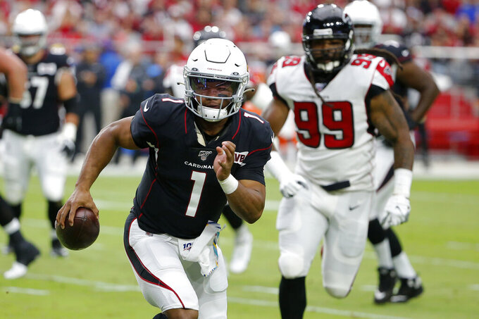 Arizona Cardinals quarterback Kyler Murray (1) scrambles as Atlanta Falcons defensive end Adrian Clayborn (99) pursues during the first half of an NFL football game, Sunday, Oct. 13, 2019, in Glendale, Ariz. (AP Photo/Rick Scuteri)