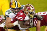 San Francisco 49ers running back Jerick McKinnon (28) runs against Green Bay Packers defensive end Dean Lowry (94) during the first half of an NFL football game in Santa Clara, Calif., Thursday, Nov. 5, 2020. (AP Photo/Tony Avelar)