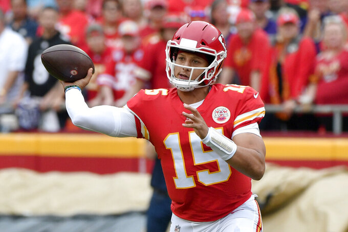 Kansas City Chiefs quarterback Patrick Mahomes (15) throws a pass during the first half of an NFL football game against the Baltimore Ravens in Kansas City, Mo., Sunday, Sept. 22, 2019. (AP Photo/Ed Zurga)