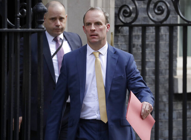 Britain's Secretary of State for Foreign Affairs, Dominic Raab, leads cabinet members as they leave 10 Downing Street after a meeting as British Prime Minister Boris Johnson was moved to intensive care after his coronavirus symptoms worsened in London, Tuesday, April 7, 2020. Johnson was admitted to St Thomas' hospital in central London on Sunday after his coronavirus symptoms persisted for 10 days. Having been in hospital for tests and observation, his doctors advised that he be admitted to intensive care on Monday evening. The new coronavirus causes mild or moderate symptoms for most people, but for some, especially older adults and people with existing health problems, it can cause more severe illness or death.(AP Photo/Matt Dunham)
