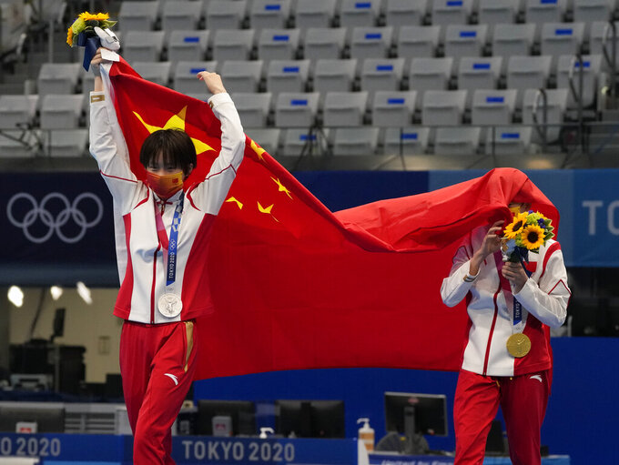 Chen Yuxi of China, left, silver medal and Quan Hongchan of China, gold medal react after winning gold medal in women's diving 10-meter platform final at the Tokyo Aquatics Centre at the 2020 Summer Olympics, Thursday, Aug. 5, 2021, in Tokyo, Japan. (AP Photo/Dmitri Lovetsky)