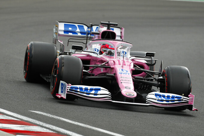 Racing Point driver Sergio Perez of Mexico steers his car during the qualifying session for the Hungarian Formula One Grand Prix at the Hungaroring racetrack in Mogyorod, Hungary, Saturday, July 18, 2020. The Hungarian F1 Grand Prix will be held on Sunday. (Darko Bandic/Pool)