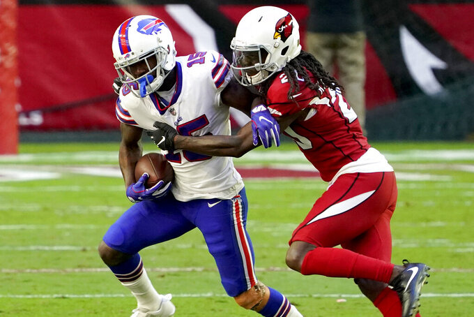 Buffalo Bills wide receiver John Brown (15) is hit by Arizona Cardinals cornerback Dre Kirkpatrick (20) during the first half of an NFL football game, Sunday, Nov. 15, 2020, in Glendale, Ariz. (AP Photo/Rick Scuteri)
