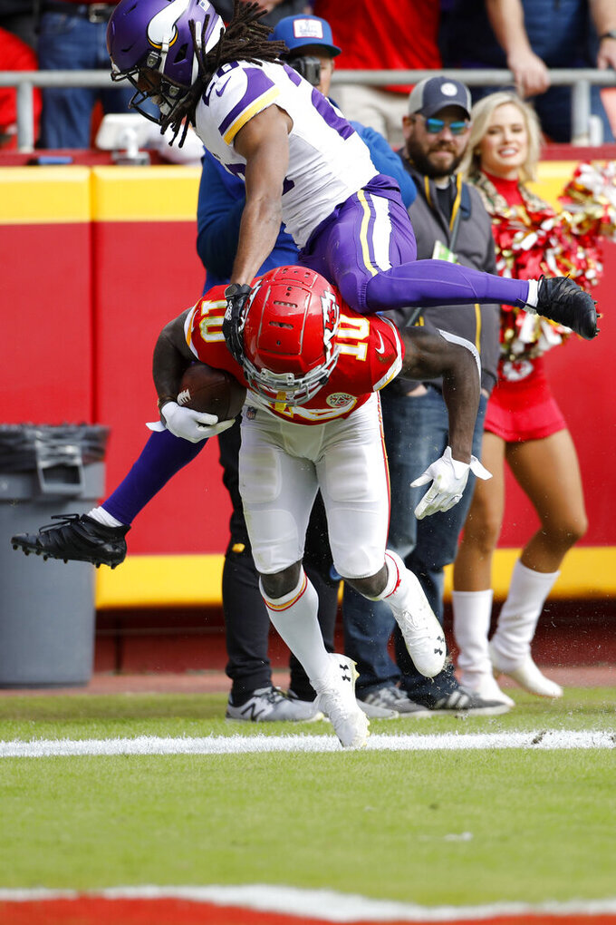 Minnesota Vikings cornerback Trae Waynes (26) vaults over Kansas City Chiefs wide receiver Tyreek Hill (10), after Hill scored a touchdown on a 40-yard pass by quarterback Matt Moore (8), during the first half of an NFL football game in Kansas City, Mo., Sunday, Nov. 3, 2019. (AP Photo/Colin E. Braley)