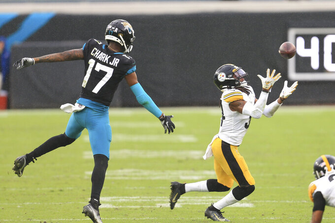 Pittsburgh Steelers safety Terrell Edmunds, right, intercepts a pass intended for Jacksonville Jaguars wide receiver DJ Chark Jr. (17) during the second half of an NFL football game, Sunday, Nov. 22, 2020, in Jacksonville, Fla. (AP Photo/Matt Stamey)