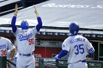 Los Angeles Dodgers' Mookie Betts (50) celebrates a two-run home run by teammate Cody Bellinger (35) against the Arizona Diamondbacks during the first inning of a baseball game Sunday, Aug. 2, 2020, in Phoenix. (AP Photo/Ross D. Franklin)
