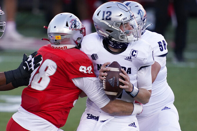 New Mexico defensive end Joey Noble (98) sacks Nevada quarterback Carson Strong (12) during the first half of an NCAA college football game Saturday, Nov. 14, 2020, in Las Vegas. (AP Photo/John Locher)