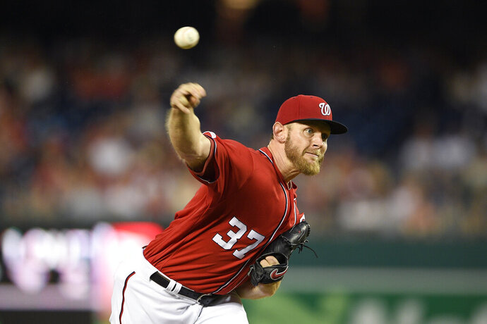 Washington Nationals starting pitcher Stephen Strasburg delivers during the third inning of a baseball game against the Miami Marlins, Saturday, Aug. 31, 2019, in Washington. (AP Photo/Nick Wass)