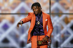 Baltimore Ravens' Lamar Jackson speaks after winning the AP Most Valuable Player award at the NFL Honors football award show Saturday, Feb. 1, 2020, in Miami. (AP Photo/David J. Phillip)