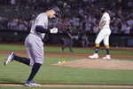 New York Yankees' Aaron Judge, left, rounds the bases after hitting a three-run home run off of Oakland Athletics pitcher Sean Manaea, right, during the fifth inning of a baseball game in Oakland, Calif., Friday, Aug. 27, 2021. (AP Photo/Jeff Chiu)