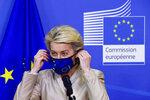 European Commission President Ursula von der Leyen prepares to welcome Austrian President Alexander Van der Bellen at EU headquarters in Brussels, Tuesday, July 13, 2021. (Pascal Rossignol, Pool Photo via AP)