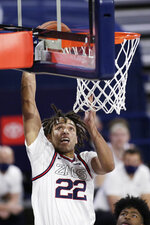 Gonzaga forward Anton Watson goes up for a dunk during the second half of an NCAA college basketball game against Northwestern State in Spokane, Wash., Monday, Dec. 21, 2020. (AP Photo/Young Kwak)