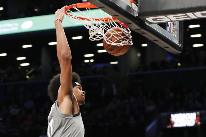 Brooklyn Nets center Jarrett Allen dunks during the second half of the team's NBA basketball game against the Charlotte Hornets, Wednesday, Nov. 20, 2019, in New York. (AP Photo/Kathy Willens)