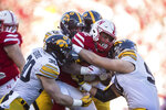 FILE - In this Nov. 24, 2017, file photo, Nebraska running back Devine Ozigbo (22) is tackled by Iowa middle linebacker Josey Jewell (43), defensive back Jake Gervase (30) and defensive end Sam Brincks (90) during the first half of an NCAA college football game in Lincoln, Neb. The last week of the regular season in the Big Ten means a slate of rivalry games. (AP Photo/John Peterson, File)