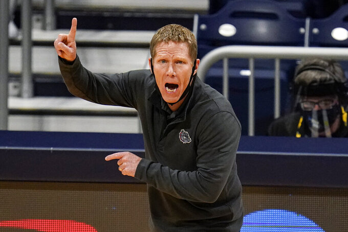Gonzaga head coach Mark Few calls a play for his team as they played against Oklahoma in the first half of a second-round game in the NCAA men's college basketball tournament at Hinkle Fieldhouse in Indianapolis, Monday, March 22, 2021. (AP Photo/Michael Conroy)