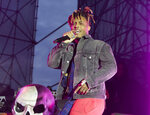 "FILE - In this May 15, 2019, file photo, Juice WRLD performs in concert during his ""Death Race for Love Tour"" at The Skyline Stage at The Mann Center for the Performing Arts in Philadelphia. The Chicago-area rapper, whose real name is Jarad A. Higgins, was pronounced dead Dec. 8 after a ""medical emergency'' at Chicago's Midway International Airport, according to authorities. (Photo by Owen Sweeney/Invision/AP, File)"