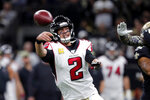 Atlanta Falcons quarterback Matt Ryan (2) passes under pressure in the first half of an NFL football game against the New Orleans Saints in New Orleans, Sunday, Nov. 10, 2019. (AP Photo/Gerald Herbert)