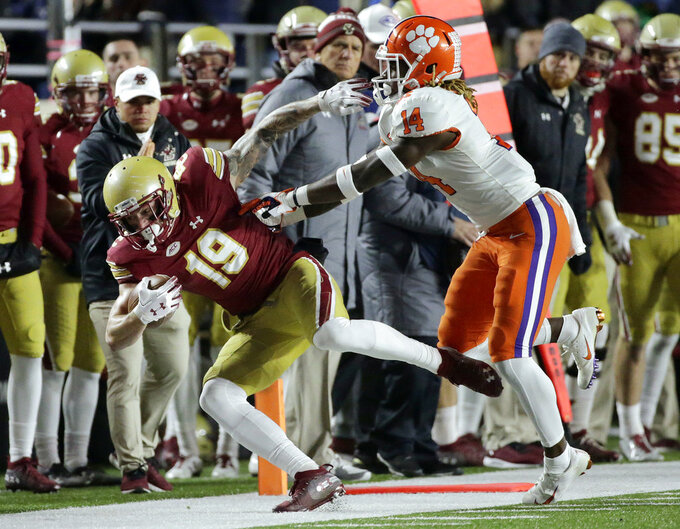 Clemson safety Denzel Johnson, right, pushes Boston College wide receiver Ben Glines out of bounds, but not before Glines gained a first down during the second half of an NCAA college football game, Saturday, Nov. 10, 2018, in Boston. (AP Photo/Elise Amendola)