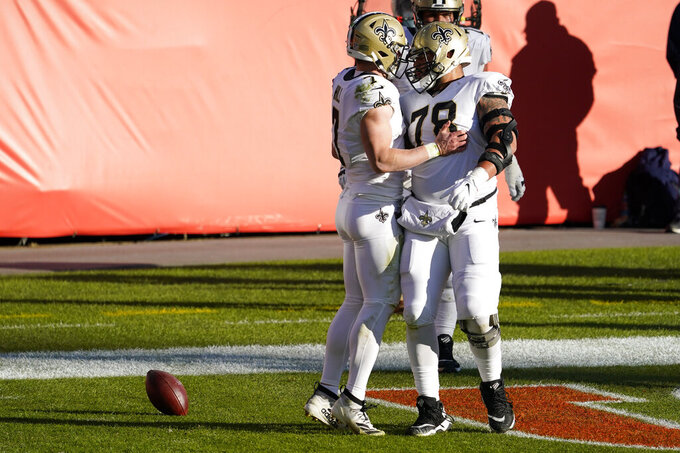 New Orleans Saints quarterback Taysom Hill (7) celebrates his rushing touchdown with center Erik McCoy (78) during the first half of an NFL football game against the Denver Broncos, Sunday, Nov. 29, 2020, in Denver. (AP Photo/Jack Dempsey)