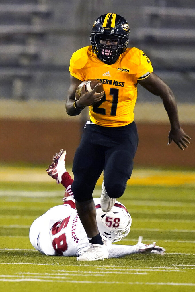 Southern Mississippi running back Frank Gore Jr. (21) runs past Florida Atlantic linebacker Eddie Williams (58) on his way to a 73-yard touchdown run during the first half of an NCAA college football game Thursday, Dec. 10, 2020, in Hattiesburg, Miss. (AP Photo/Rogelio V. Solis)