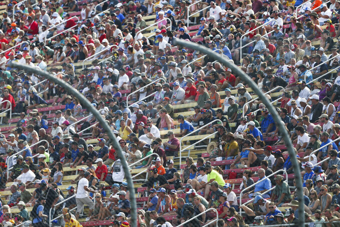 A crowd fills the grandstand during a NASCAR Cup Series auto race in Watkins Glen, N.Y., on Sunday, Aug. 8, 2021. (AP Photo/Joshua Bessex)