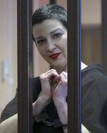Belarus' opposition activists Maria Kolesnikova stands in cage during a court hearing in Minsk, Belarus, Monday, Sept. 6, 2021. A court in Belarus on Monday sentenced two leading opposition activists to lengthy prison terms, the latest move in the relentless crackdown Belarusian authorities unleashed on dissent in the wake of last year's months-long anti-government protests. Maria Kolesnikova, a top member of the opposition Coordination Council, has been in custody since her arrest last September. A court in Minsk found her guilty of conspiring to seize power, creating an extremist organization and calling for actions damaging state security and sentenced her to 11 years in prison. Maxim Znak was sentenced to 10 years in prison. (Ramil Nasibulin/BelTA pool photo via AP)