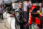 Conor Daly stows his helmet following practice for the Indianapolis 500 auto race at Indianapolis Motor Speedway in Indianapolis, Thursday, May 20, 2021. (AP Photo/Michael Conroy)