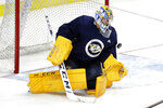 Nashville Predators goaltender Juuse Saros, of Finland, blocks a shot during NHL hockey training camp, Tuesday, July 14, 2020, in Nashville, Tenn. (AP Photo/Mark Humphrey)