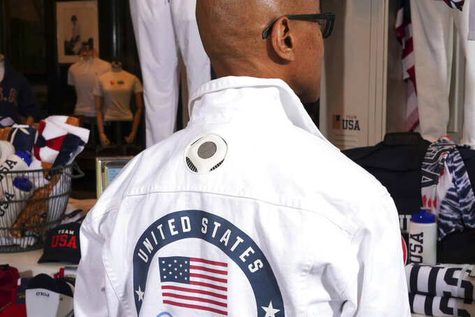 FILE - Former Olympic medalist in fencing Peter Westbrook models the Team USA Tokyo Olympic opening ceremony flag bearer uniform that features cooling technology at the Ralph Lauren SoHo store on July 7, 2021, in New York. Olympic gear makes for lively social media fodder, starting with the hours-long Parade of Nations. The year's wait due to the pandemic has given enthusiasts extra time to ponder what they love or hate. (Photo by Charles Sykes/Invision/AP, File)