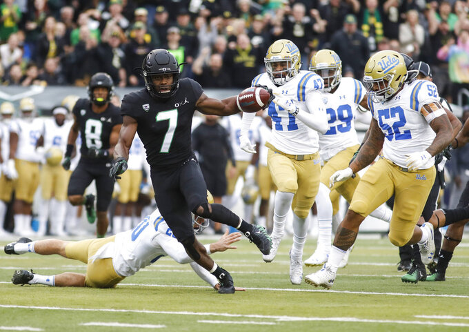 Oregon safety Ugochukwu Amadi (7), runs back a punt return for a touchdown against UCLA in the first quarter during an NCAA college football game in Eugene, Ore., Saturday, Nov. 3, 2018 (AP Photo/Thomas Boyd)