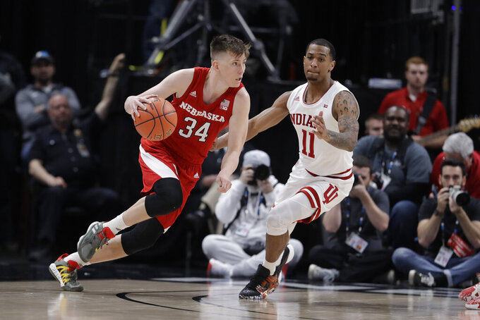 Nebraska's Thorir Thorbjarnarson (34) is defended by Indiana's Devonte Green (11) during the first half of an NCAA college basketball game at the Big Ten Conference tournament, Wednesday, March 11, 2020, in Indianapolis. (AP Photo/Darron Cummings)