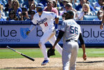 Los Angeles Dodgers' A.J. Pollock, left, drops his bat as he hits a three-run home run as Miami Marlins relief pitcher Tayron Guerrero watches during the seventh inning of a baseball game Sunday, July 21, 2019, in Los Angeles. (AP Photo/Mark J. Terrill)