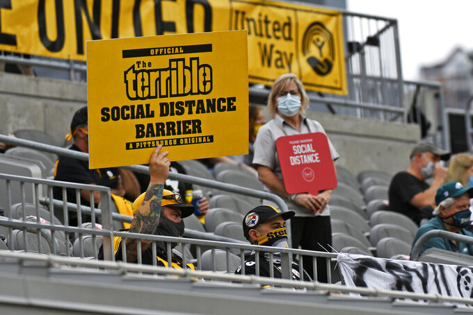 A Pittsburgh Steelers fan holds a sign during the first half of an NFL football game against the Philadelphia Eagles in Pittsburgh, Sunday, Oct. 11, 2020. (AP Photo/Don Wright)
