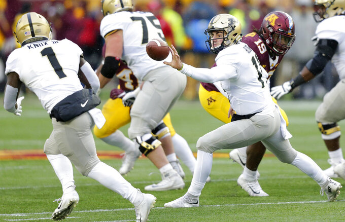 Purdue quarterback David Blough (11) pitches to Purdue running back D.J. Knox (1) in the first quarter against Minnesota in a NCAA college football game Saturday, Nov. 10, 2018, in Minneapolis. (AP Photo/Andy Clayton-King)