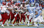 North Carolina State, left, and North Carolina players scuffle following the game-winning touchdown by North Carolina State's Reggie Gallaspy II (25) in overtime of an NCAA college football game in Chapel Hill, N.C., Saturday, Nov. 24, 2018. North Carolina State won 43-28. (AP Photo/Gerry Broome)