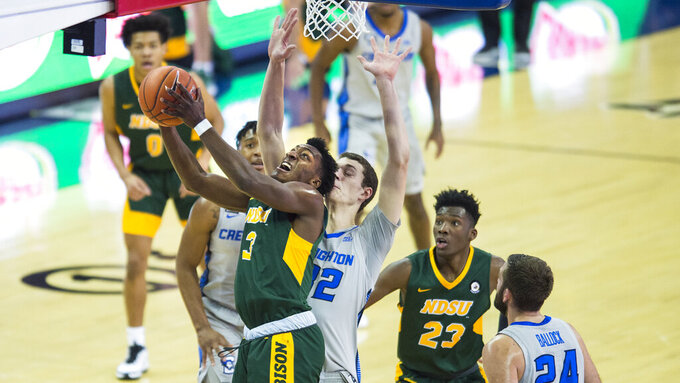 North Dakota State's Tyree Eady, left, rebounds against Creighton's Ryan Kalkbrenner, center, during the first half of an NCAA college basketball game in Omaha, Neb., Sunday, Nov. 29, 2020. (AP Photo/Kayla Wolf)