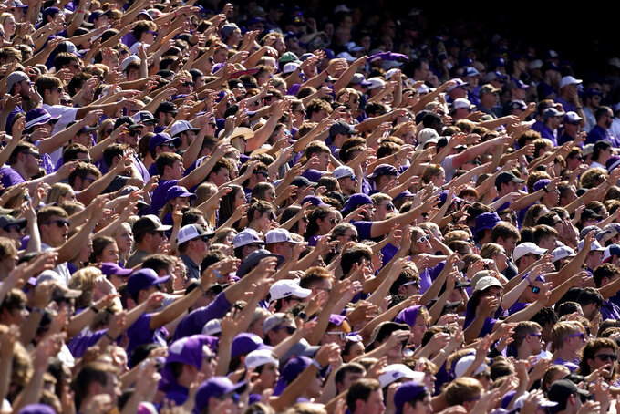 Kansas State fans cheer during the first half of an NCAA college football game against Nevada Saturday, Sept. 18, 2021, in Manhattan, Kan. (AP Photo/Charlie Riedel)