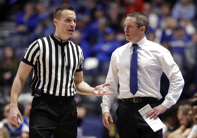 Florida head coach Mike White argues a call in the first half of an NCAA college basketball game against LSU at the Southeastern Conference tournament Friday, March 15, 2019, in Nashville, Tenn. (AP Photo/Mark Humphrey)
