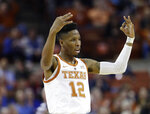 Texas guard Kerwin Roach II (12) celebrates a score against Kansas during the first half on an NCAA college basketball game in Austin, Texas, Tuesday, Jan. 29, 2019. (AP Photo/Eric Gay)