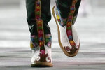 Team member of Bhutan walks during the opening ceremony in the Olympic Stadium at the 2020 Summer Olympics, Friday, July 23, 2021, in Tokyo, Japan. (AP Photo/Petr David Josek)