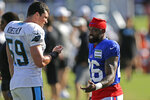 Carolina Panthers' Luke Kuechly (59) and Buffalo Bills captain Munnerlyn chat during an NFL football training camp in Spartanburg, S.C., Wednesday, Aug. 14, 2019. (AP Photo/Gerry Broome)